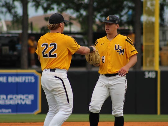 Southern Miss teammates Taylor Braley, left, and Kirk