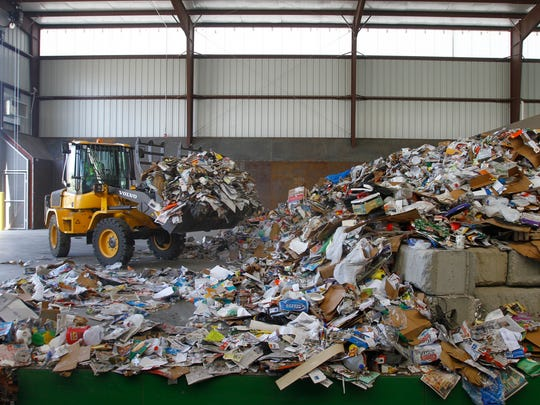 A front end loader operates at the recycling center Thursday at the San Juan County landfill.