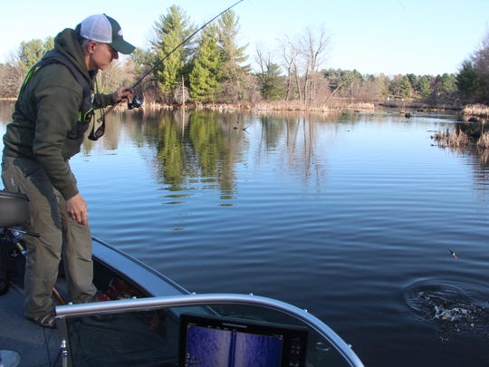 Jason Halfen of Eau Claire prepares to land a largemouth