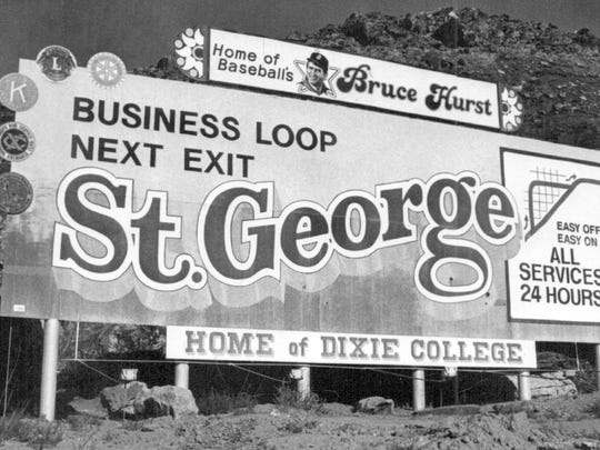 The billboard on Interstate 15 just south of the Virgin River proclaimed St. George as the home of baseball's Bruce Hurst in November of 1986, just after Hurst and the Boston Red Sox lost the 1986 World Series to the New York Mets as can be seen in the then photo taken by Spectrum photographer Nancy Rhodes. The billboard still exists today, although it has been changed several times since 1986. The St. George City trail system now includes a section of the Bloomington Hills trail that runs right in front of the billboard as is evidenced by a jogger running past the sign in the now image taken by The Spectrum's Jud Burkett.