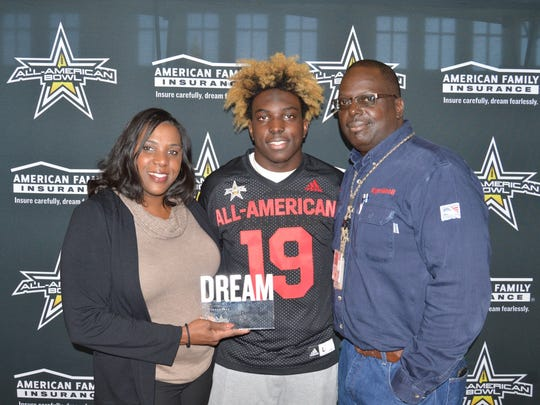 Christian Harris presented his parents with his Dream Champion Award. (Photo: AAG)
