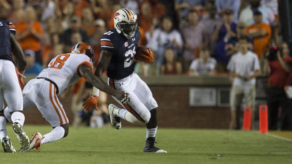 Auburn running back Kerryon Johnson (21) runs as Clemson safety Jadar Johnson tackles him during the Auburn vs. Clemson NCAA Football game at Jordan-Hare Stadium on Saturday, Sept. 3, 2016, in Auburn, Ala. Albert Cesare