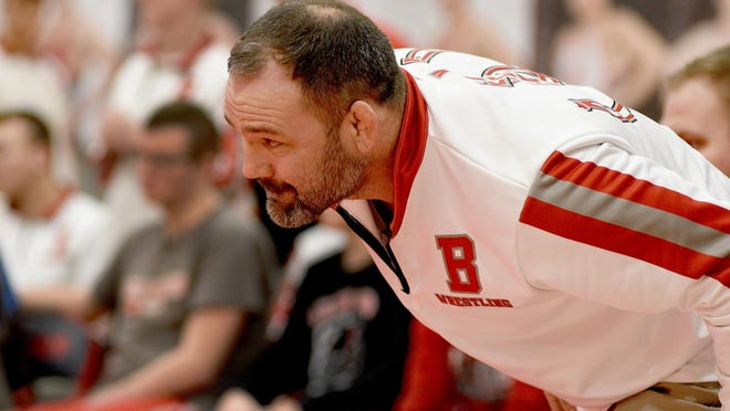 Bedford wrestling coach Kevin Vogel intently watches a match during the District finals.