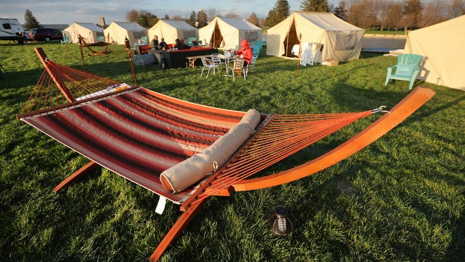 """Several hammocks grace the """"Glamping"""" site at the Indianapolis Motor Speedway on Tuesday, April 15, 2014. The glamorous tents, ranging from $650-$1100, will be available to campers three days before the race. The price includes tickets to the race as well as Carb Day and Legends Day."""