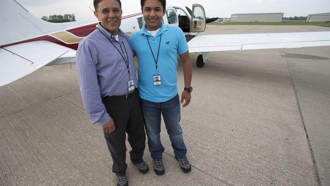 Babar Suleman and his son Haris Suleman, 17, before the flight.  Robert Scheer/The Star