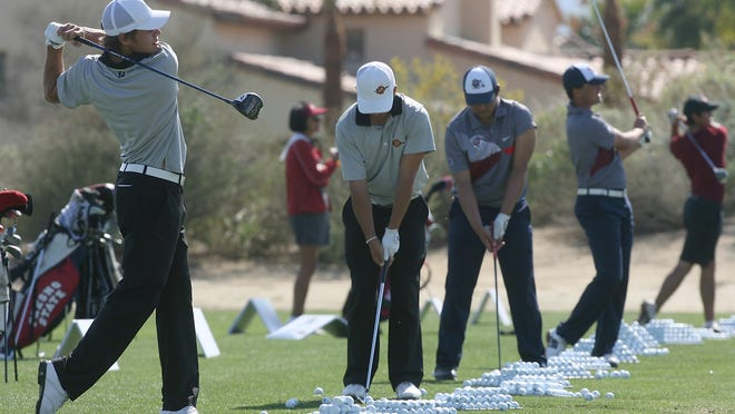 Players warm up at the Prestige College golf tournament at the PGA West Norman course last year. The tournament will be played for the 17th year in the desert starting with a junior clinic and college-am Sunday.