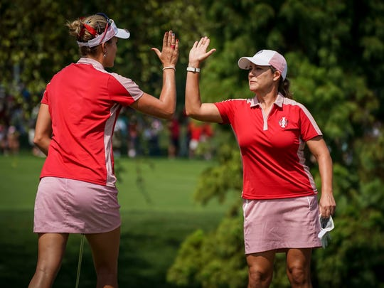 Cristie Kerr, right, high fives teammate Lexi Thompson on the 17th green during their Solheim Cup Foursome Matches Friday, Aug. 18, 2017, at the Des Moines Golf and Country Club in West Des Moines, Iowa.