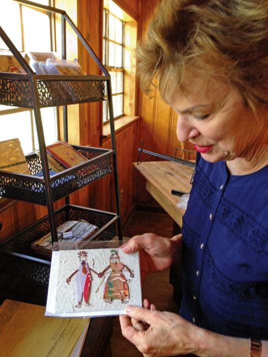 Rebecca Ponder shows a card made of recycled materials in The Annex, the new retail Fair Trade outlet at Sacred Grounds.