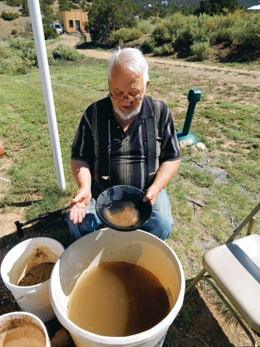 Bob Reynierson demonstrates how to pan gold.