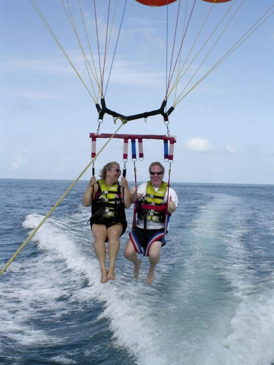 """Beth Ney of Dover Twp writes, """"My daughter, Laurie and her husband, Tim, para-sailing near Key West, Florida."""""""