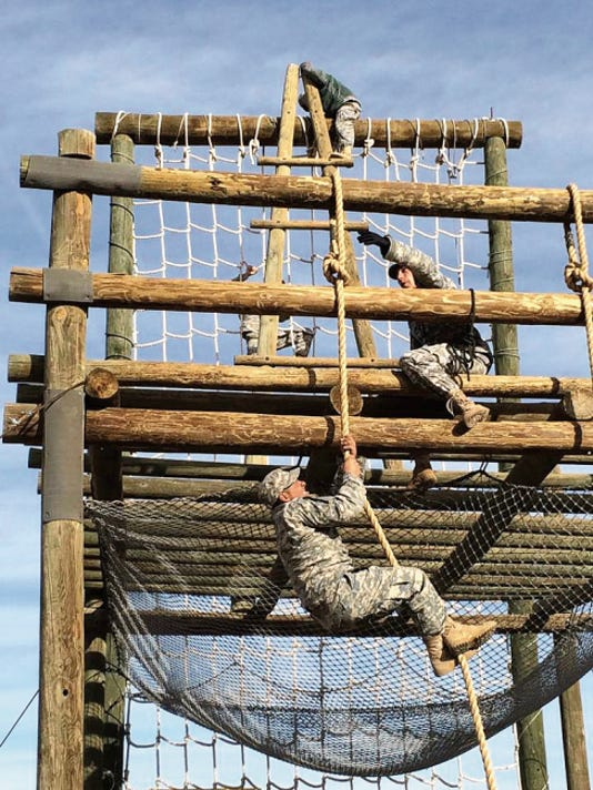 Spc. Julian Sanchez of 40MAC, 2E, climbs a rope during to the obstacle course Feb. 23.