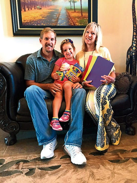 Courtesy Photo   Joel, Maddie and Shannon Stevens have started the back-to-school supply drive at Mango Maddies.