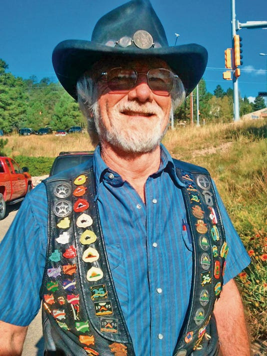 Ron Andrews, co-organizer of the Golden Aspen Motorcyle Rally, sporting one of his pinnned leather vests.
