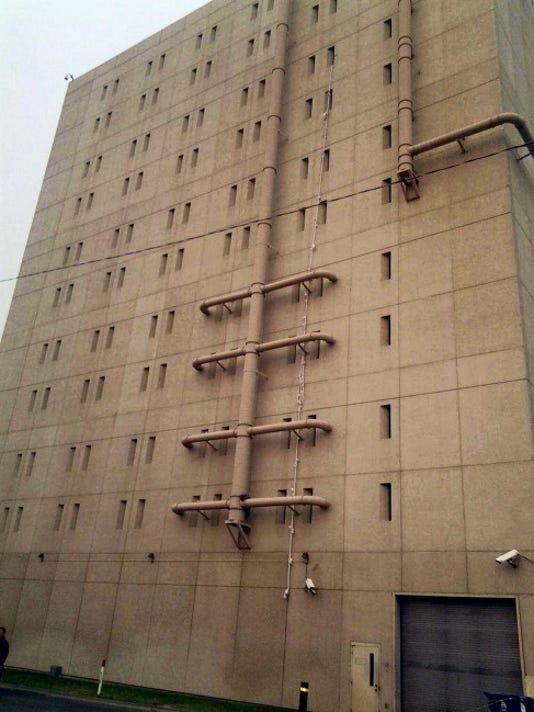 Reed Schmitt — KHQ-TV In this video image, bed sheets hang from a top floor window of the Spokane County Jail.