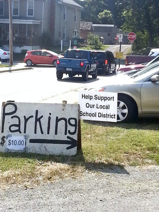 Patrons thought the 10 fee they paid to park in a makeshift lot at Saturday's Shippensburg Corn Festival would become part of a contribution to the local school district  but that's not exactly the case. The operator of the parking lot, businessman Elam Reiff, says the proceeds became part of his school tax payment.