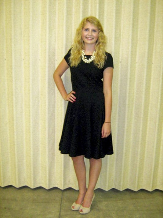 Katie Kreider, Lebanon, shows off the outfit she made that placed first in the State 4-H Fashion Revue.