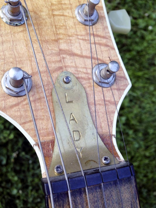 The brass truss rod cover was made in the prison metal shop.