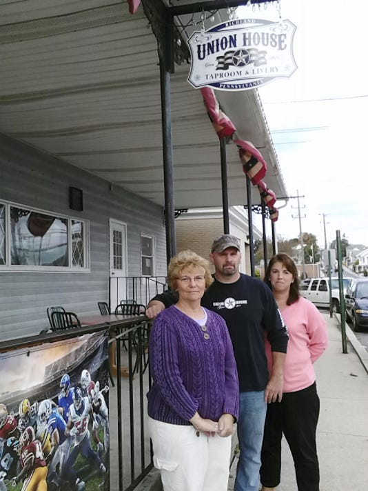 Standing outside the Union House Taproom and Livery in Richland recently are, from left, Stephanie Seldomridge, mother of the late Stacey Seldomridge Pennington, and Stacey's high school classmates George Savich, owner of the Union House, and Rachelle Keath. A fundraiser will be held Saturday at the restaurant to benefit a scholarship in Stacey's name.
