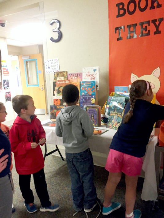 Elco second grade students, from left, Jordan Weitzel, Chase Lutz, Elejandro Eckert, and Katie Bochenek shop for books through Books for Bucket Fillers, a free book program to encourage independent reading at school and at home.