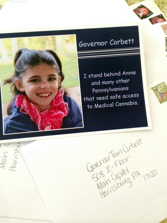 Postcards like the one photographed here are being sent to Gov. Tom Corbett as part a plan to inundate the office with cards in support of Senate Bill 1182, the Compassionate Use of Medical Cannabis Act. Pictured in the card is Annie Sharrer, 9, of Tyrone Township, Adams County. Annie suffers multiple seizures every week due to her epilepsy that her parents, Angie and Matt Sharrer, want to treat with medical cannabis.