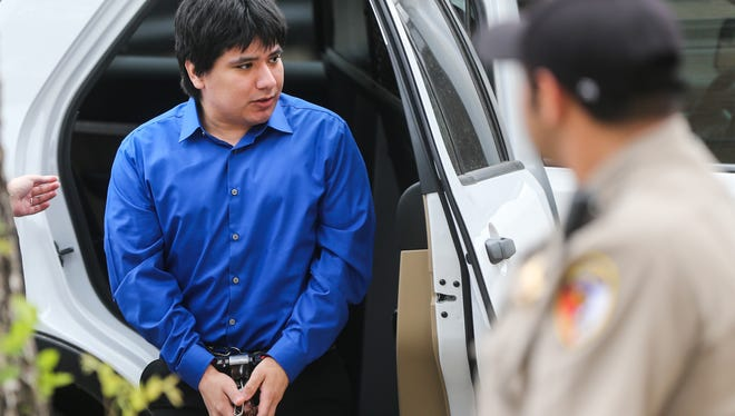 Isidro Delacruz, a capital murder suspect, arrives for a hearing Wednesday, May 31, at the Tom Green County Courthouse.