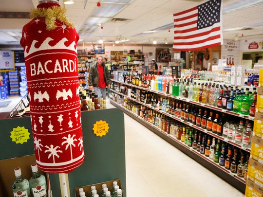 Holiday themed displays are scattered throughout Tower Liquors Thursday, December 21, 2017, at 981 S. Creasy Lane in Lafayette.