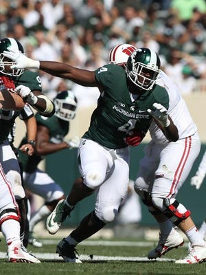 Michigan State Spartans defensive lineman Malik McDowell rushes against the Wisconsin Badgers in the first half Saturday, Sept. 24, 2016 at Spartan Stadium in East Lansing.