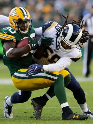 Green Bay Packers' running back Jamaal Williams fights for yardage in 2017 game against the Los Angeles Rams.