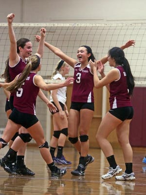 Scarsdale celebrates after defeating Clarkstown North in a Section 1 Class AA quarterfinal volleyball match at Scarsdale High School Tuesday. Scarsdale won 25-17; 25-15; 20-25; and 25-21.