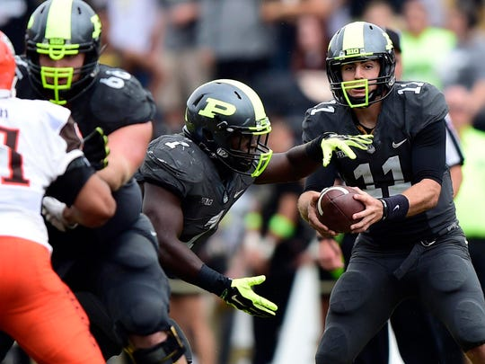 Purdue Boilermakers quarterback David Blough (11) hands the ball off to running back D.J. Knox (1) during the second half of the game at Ross Ade Stadium. The Bowling Green Falcons defeated the Purdue Boilermakers 35 to 28.
