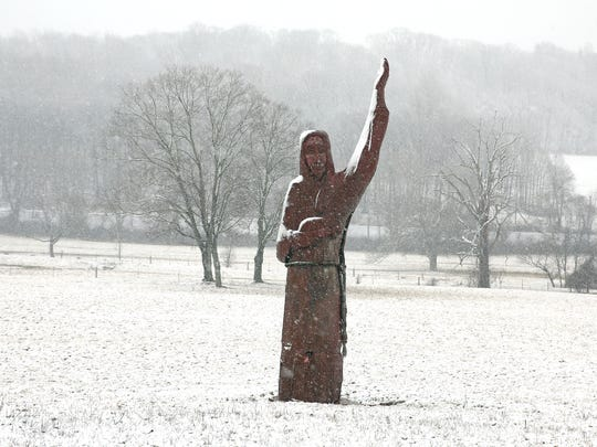 Heavy snow fall on the Good Shephard Church sculpture