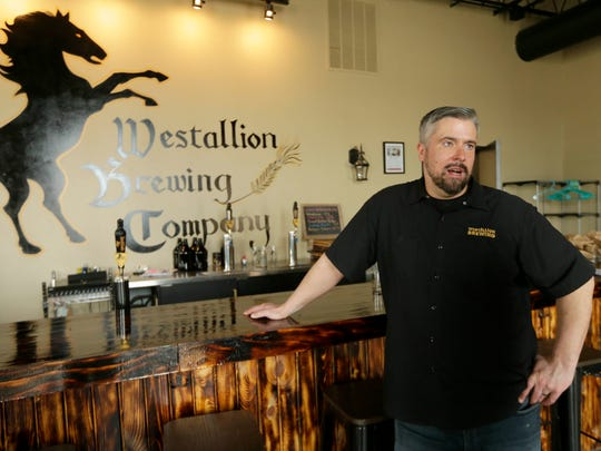 Erik Dorfner, owner of Westallion Brewing Co., at 1825 S. 72nd St., in West Allis talks about a joint fundraiser he held at the bar with two other businesses earlier this year to raise money they hope will offset budget cuts of art and music in West Allis schools.