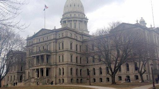 A bill approved Tuesday by a Senate panel would allow for Michigan tax incentives for jobs created in neighboring states.