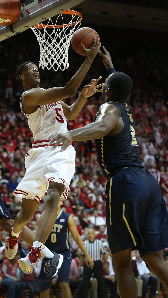 Troy Williams (5) and Indiana had plenty of success against Pitt's 2-3 zone Tuesday, thanks to good ball movement and alert back-cutting.