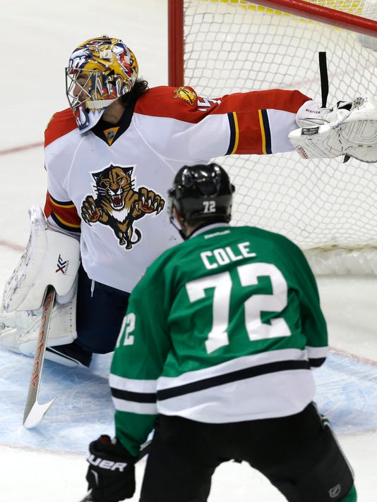 Florida Panthers goalie Al Montoya (35) defends the goal against Dallas Stars right wing Erik Cole (72) during the second period of an NHL hockey game Friday, Feb. 13, 2015, in Dallas. (AP Photo/LM Otero)