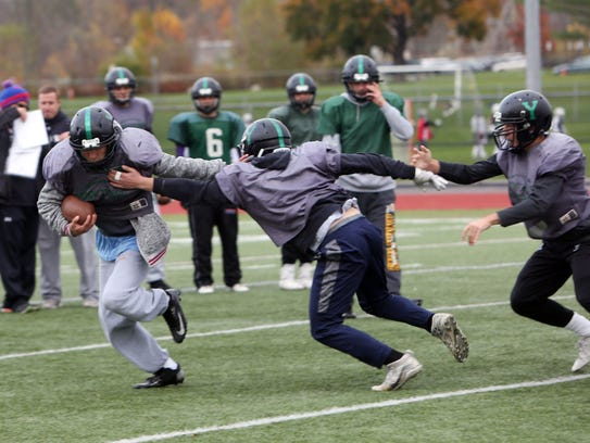 Yorktown players work on a defensive drill during practice