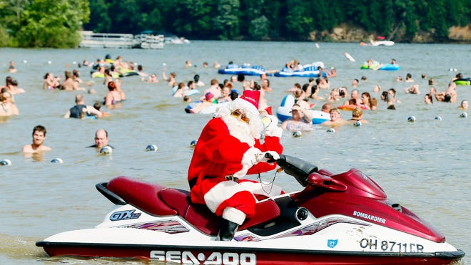 Pleasant Hill Lake Park will host Christmas in July Friday through Sunday, with a cameo by Santa Claus on a jet ski.