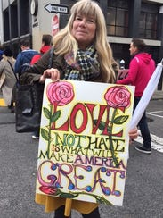 Melissa Alexander shows off her sign at the Women's