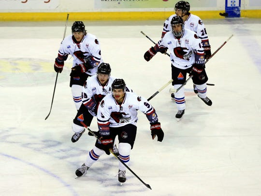 GABE HERNANDEZ/CALLER-TIMESIceRays players celebrate after scoring against the Lone Star Brahmas during the first period Saturday, Nov. 19, 2016, at the American Bank Center in Corpus Christi.
