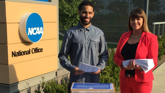 Brenda Tracy (right) and her son Darius Adams, delivered petitions to NCAA headquarters Wednesday.