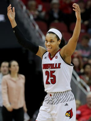 Louisville Asia Durr celebrates after Pitt calls a timeout.