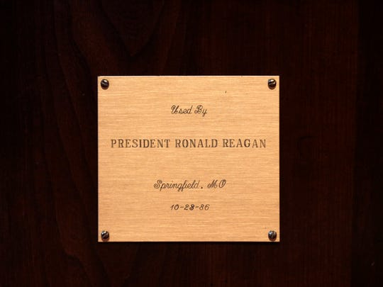A plaque on the desk in the office of the president