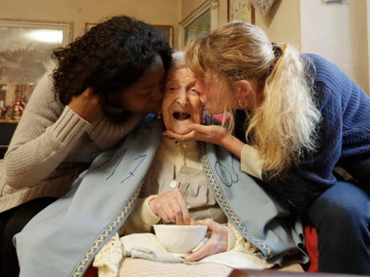 Emma Morano, 117 years hold, is kissed by her caretakers