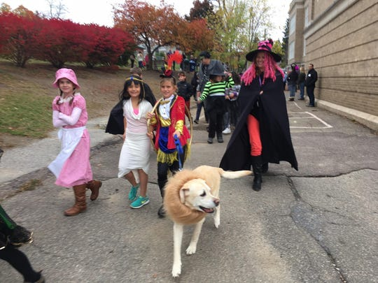 A dog marches along with Edmunds Elementary School students in Burlington.