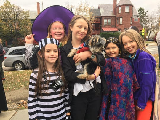 Edmunds Elementary School students pose outside the school on Halloween.
