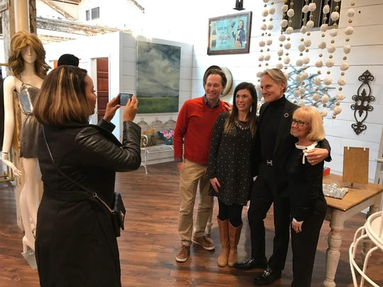"Monte Durham (center) host of TLC's ""Say Yes to the Dress"" stopped for a photo with shoppers at Work the Metal in Butchertown Market Friday. Durham was in town to judge the Kentucky Derby Festival Royal Court Princess finalists"