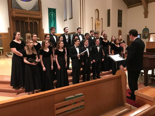 The Ursuline and Salesianum Mixed Choir performs at the 9th Annual Spiritual Festival at St. Helena's Church.