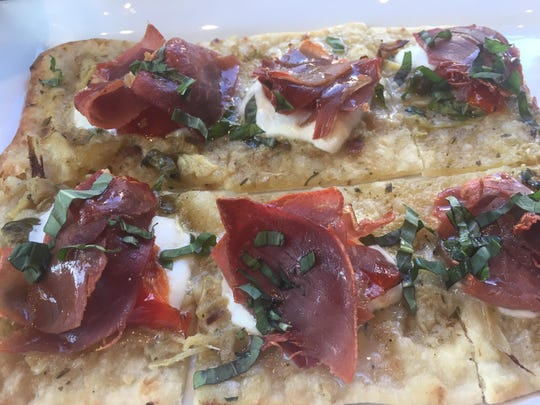 Flavorful flatbreads can be topped with chicken, Genoa