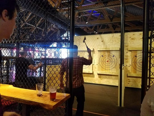 The Hub Stadium in Auburn Hills started offering ax throwing in September.