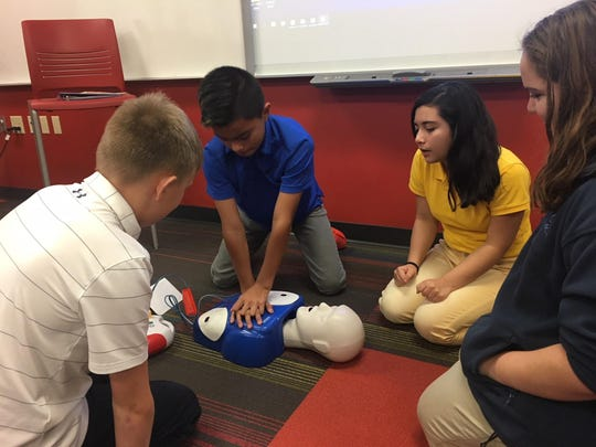 The seventh- and eighth-grade students of St. Mary Catholic Middle School recently had CPR and AED training in their health class. Pictured are, from left, Owen Ripley, Oscar Arroyo (practicing CPR), Maryuri Covarrubio and Italia Erato.